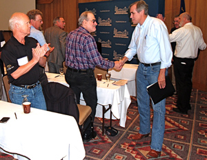 U.S. Sen. Jeff Merkley greets delegates after speaking at the 52nd annual convention of the Oregon State Building and Construction Trades Council.  He is pictured above shaking hands with A.J. Blair, financial secretary of Iron Workers Shopmen Local 516. At the left is Stan Daniels, business manager of Insulators Local 36.