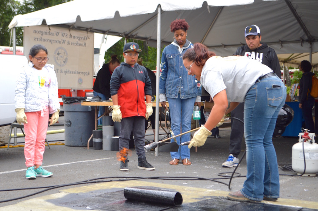 Apprentice Rosa Rivera of Roofers Local 49 demonstrates a roofing technique. Rivera recently qualified to compete in the Western Regional Roofers apprenticeship contest to be held in Los Angeles later this summer.